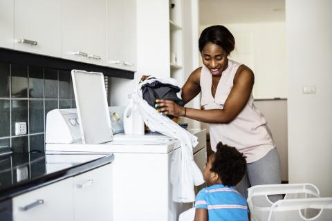 Mother and son doing laundry together