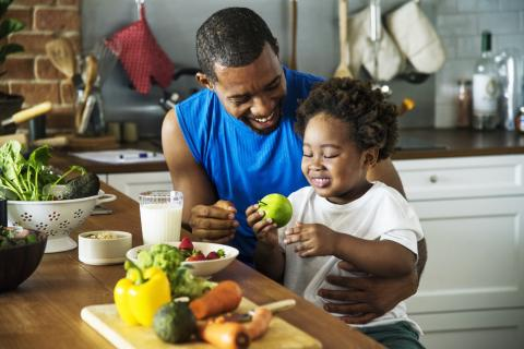 A father teaches his young child about nutrition.