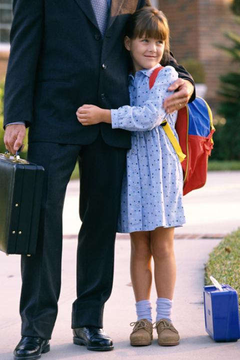 Daughter hugging dad before going off to school